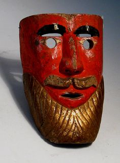 Bearded dance mask, Michoacan  Mexico  Carved wood  Circa 1920  H. 10 in.  Inventory# N221    An early mask which is an interesting and rare example of Michoacan lacquer work combined with dance mask artistry.