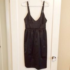 Little Black Satin Dress Brand new never worn. V front with a low back, extra sexy. Satin finish. Perfect for the holidays ❤️ French Connection Dresses