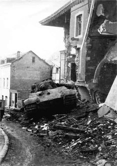 King Tiger tank of the Schwere SS Panzer-Abteilung 501. Tank number 105. Stavelot December 1944 2 This tank bogged down on debris and was immobilized, causing the crew to abandon it, which then led to it's capture by US forces. This is in a documentary also « World War Photos