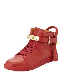 """Buscemi pebbled calfskin leather sneaker with golden hardware. 1.8"""" flat platform heel. Lace-up front. Ankle strap with 18K gold plated brass padlock/turn-lock closure. Oversized pull loop with key an"""