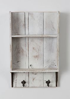 This shelf is made 100% out of reclaimed wood. We use old barn and fence wood with a light white wash to bring out the rustic appeal. The hooks