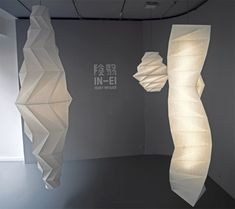 issey miyake: IN EI for artemide / each of ten lamp designs utilizes special fabric derived from recycled PET bottles, processed using an innovative technology that reduces both energy consumption and CO2 emissions up to 80% when compared to the production of new materials. the designs are created using 2D and 3D mathematical principals to define their shape and extent of light shading.