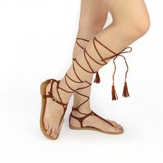 For warm weekend looks, pair these strappy sandals with a floral cami romper, crochet lace white choker, a twist-front headwrap. #sandals #strappysandals #laceups #trending #tassel #thongsandals #trendyshoes