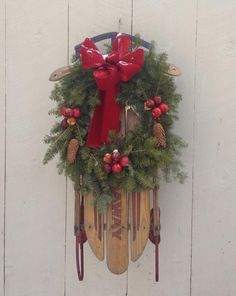 holiday decorating a vintage sled simply decorated