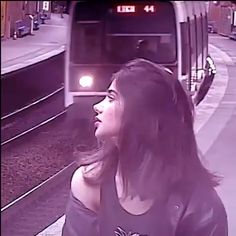 Woman in the train station dancing with synthwave song and graffiti
