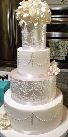 Pure Elegance!!!! Wedding Cake ~ Sugar Flowers, roses, hydrangeas, leaves, buds, filler flowers, luster finish, stencil and pearls.    ᘡղbᘠ