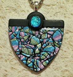 https://flic.kr/p/8FTVCi | Shimmer & Sparkle | Blue, green, pink metallic colours sealed under a shiny layer of resin.  A dichroic gem adds a special accent.  This is an extra large pendant!  Available in my online store at Artfire.