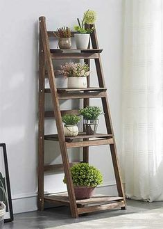 Plant Stand Discover What Makes this Plant Ladder Shelf Better than Other Houseplant Display Tables? How to Set it Up Use it Outdoors and Instructions n How to Build Your Own. Plant Shelves Outdoor, Plant Ladder, Garden Shelves, Ladder Shelf Decor, Ladder Display, Display Shelves, Wooden Ladder Decor, Wooden Ladders, Display Ideas