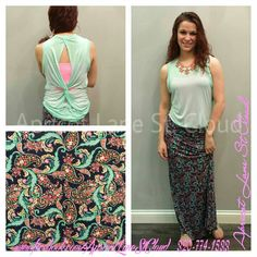 Paisley print maxi skirt ($28) in fun and trendy colors. This is taking a classic print but making it up to date and right on trend with the colors that they used in the print. We have it paired with a mint tank top with a twist in the back ($24) and layer a bandeau or a Niki Biki tank underneath. Ws accessorized with a cute bauble necklace ($24) in pink. Wear sandals, flip flops, or wedges to finish the outfit. If you would like to add this to your closet give us girls of Apricot Lane St…