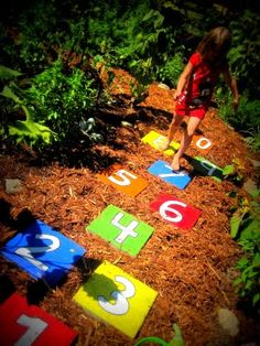 Read Between the Limes: Hopscotch Stepping Stones- and a DRAMM Giveaway!. Spray paint, stencil then paint #s. Outline in blk perm. Marker to cover up imperfections. Path to new pool.