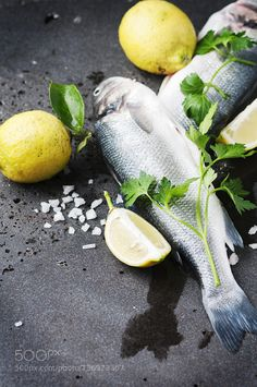 Raw seabass with salt lemon and parsley by OxanaDenezhkina  IFTTT 500px european background catch close-up cold cooking dark delicious dicentrarchus diet dinn