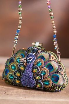 Mary Frances peacock purse-Love the bag! Peacock WEdding Stunning wall art with peacock illustrations, peacock paintings and masks go well with Mardi gras celebrations of blue, purple and green. Handbags Michael Kors, Purses And Handbags, Mk Handbags, Mardi Gras, Purple Wedding Shoes, Peacock Wedding, Wedding Blue, Peacock Purse, Green Peacock