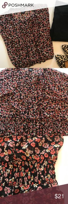 "Torrid Floral Blouse Slightly sheer. Smocking at the waistband. 30"" long. 26"" across chest. torrid Tops Blouses"