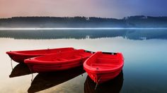 Red boats beside the lake, Sauerland, North Rhine-Westphalia, Germany
