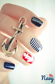 Nautical Nail art Navy nails with chain link and small stripe designs in white with a bright red accent nail decorated with a white anchor!