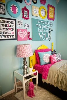 Cute wall decor and I love the yellow painted bed and pink poodle!