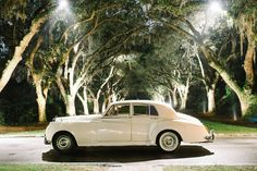 White Classic Bentley as a getaway car at a Southern wedding in Charleston, SC // Aaron and Jillian Photography