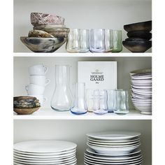 Mix a number of transparent pastels with white tableware. The design sits comfortably in your hand – and is ideal even for the youngest members of the family who quickly pick their favourite colour. Peter Svarrer's mouth blown tumblers from the Future range are ideal as colourful decoration on open kitchen shelves. This pack contains two glasses, one blue and one green.  #holmegaard #future #tumbler #transparentpastels