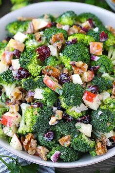 This broccoli salad with apples, walnuts, and cranberries is sweet, crunchy, and tangy. It's the perfect make-ahead side recipe since it doesn't get soggy and it makes a ton! Paleo, dairy free, gluten free, and vegetarian. #vegetarianrecipes #paleorecipes