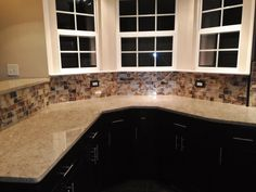 Kitchen Remodel- Curved Silestone Countertop, Glass Backsplash tiles
