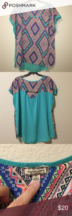 Eyeshadow geometric print shirt. Size 1X Super cute, bright colors and very comfy. Worn twice. I've gotten tons of compliments on this shirt. Great condition. No longer fits. Eyeshadow Tops Blouses