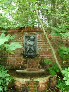 Google Image Result for http://images.fineartamerica.com/images-medium/fountain-on-a-red-brick-wall-c-thomas-cooney.jpg