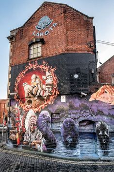 Artist: Cheo. Artist: Minto.A stunning mix of two artists' styles wrap around this iconic Stokes Croft building. #streetart