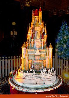 """Gingerbread Castle // 12 foot high """"Sugar Castle"""" created by Executive Pastry Chef Jean-François Houdré. The castle sits atop a rotating platform so you can see every inch of it while standing in one place and there's a miniature train that circles its base."""