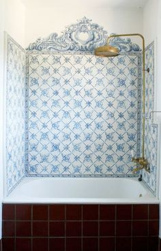 Walled in tub with decorative powder blue  tile