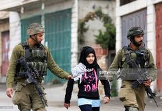 Palestinian school girl is arrested and taken away by Israeli soldiers during clashes with Palestinian demonstrators in the West Bank town of Beit Ummar.Israeli soldiers stormed the West Bank town of Beit Ummar, northwest of Hebron during clashes with Palestinian youth. Israeli soldiers fired tear gas at Palestinian youth who were protesting, most of whom were school-age/ Soldiers later stormed the village, firing rubber-coated steel bullets as well as live fire in the streets. Palestinians…