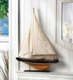 SHIPS FREE Sail away on dreams of adventure; let this magical ship be your guide! Stunning wood and canvas model is so amazingly lifelike, you'll practically hear the waves breaking over the bow. The perfect gift for any true sailor at heart! Some assembly required. Item 14749