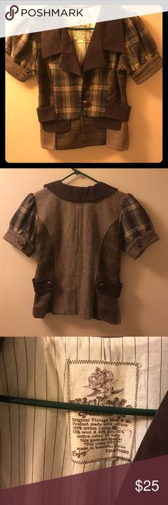 Gorgeous Nick & Mo 90's Vintage Tweed Jacket This jacket is truly one of a kind. The craftsmanship and originality is sure to get you many compliments. In excellent used condition besides a small hole in the lining, see picture 4, should not affect wear at all. Nick and Mo Jackets & Coats