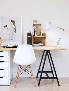 wood desk table top with black saw horse leg and white filing cabinet…