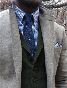 Most excellent. Grey overcoat, green cord blazer or vest, blues.