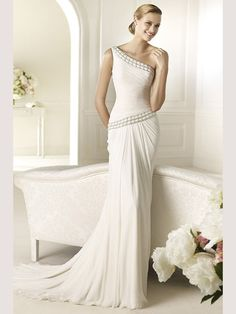 'Pronovias' Very chic draped gown, very flattering.