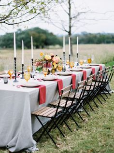 This red-and-yellow-themed wedding table is decidedly fall, without use of a single gourd. While red and orange may come off as Halloween-centric, the pairing of vibrant red napkins and light yellow goblets create a bold, yet sophisticated, aesthetic.  Via Junebug Weddings