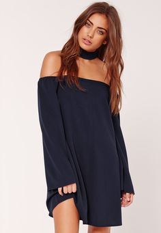Nail the navy and get choked up in this swing dress with a chic bardot style.