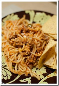 TACO SPAGHETTI    8 oz. spaghetti, cooked    1 lb. ground turkey    1 {16 oz.} salsa {I used Joe T. Garcia's}    1 {8 oz.} can tomato sauce {I used Hunt's}    1 pkg. taco seasoning {I used McCormick's}    1/4 cup sour cream    2 cups Mexican Cheese Blend