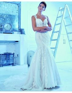 Lovely lace trumpet available at Spotlight Formal Wear! #SpotlightBridal