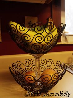 DIY Fruit Stand--Candle holder and cheap baskets!  To make it  just invert the candle holder and with some liquid nail, glue it together using bananas for weight until it dries...