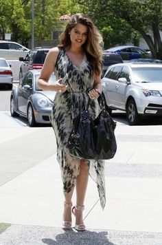 Khloe Kardashian summer street style with printed maxi dress