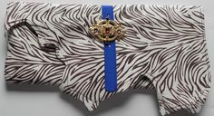 Delicious!!   Brown/Cream zebra print leather, with blue strap, gold jeweled broach