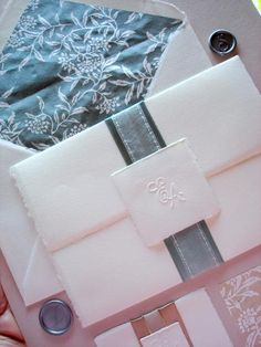 Handmade,deckle edge trifold invitation with crest.  Fully customizable. clovercreek.com