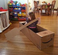 How cute is this toddler in a homemade cardboard canoe