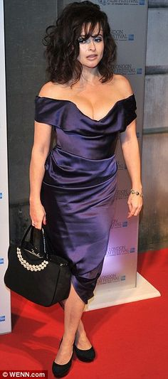 Helena Bonham Carter cuts a shapely figure as she shows off her hourglass curves in a corseted dress   Mail Online