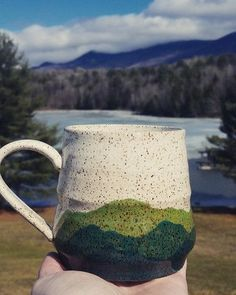 Handmade Green Mountain Mugs For all your adventures in Vermont here's to remembering the beauty of them. Dishwasher & Microwave safe but hand washing always preferred. Each mug is one of a kind in de