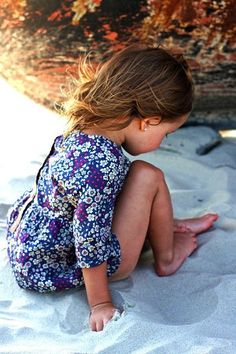 This is cute little girl on the beach!