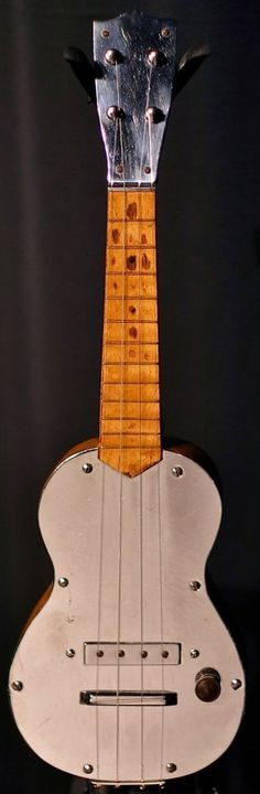 I am told this is the earliest known fully electric Ukulele and that it dates from 1938, (or possibly earlier?) It was possibly made by Vega as something similar appears in their 1938 catalogue but people who have seen it, rather than just a photo...