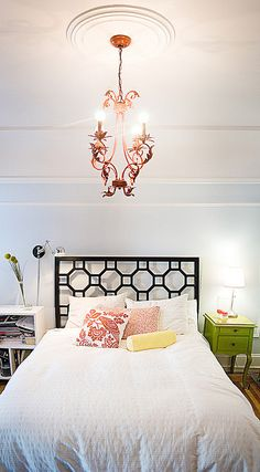 chandelier is cool, nice colors (light blue wall, apple green and tomato red)