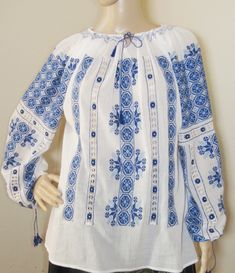 Beautifully hand embroidered Romanian traditional blouse. The embroideries are hand made with white silk thread, dark blue and medium blue cotton thread and every pattern is unique and gorgeous in its design. The finest and sheer gauze cotton. Authentic, original, 100 % hand stitched and hand embroidered, an embroiderer needs 6 weeks to produce one blouse. Silk Thread, Cotton Thread, Peasant Blouse, Embroidered Blouse, White Silk, Hand Stitching, Ethnic, Tunic Tops, Pure Products